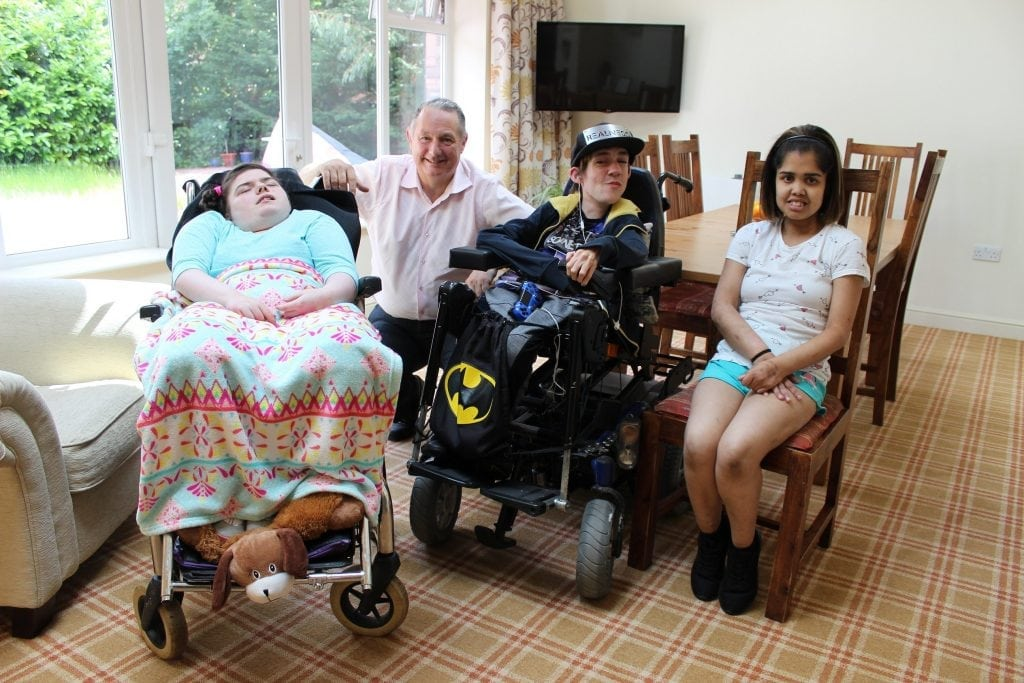Young people with life-limiting conditions in the lounge at 463 with Dermot Murphy
