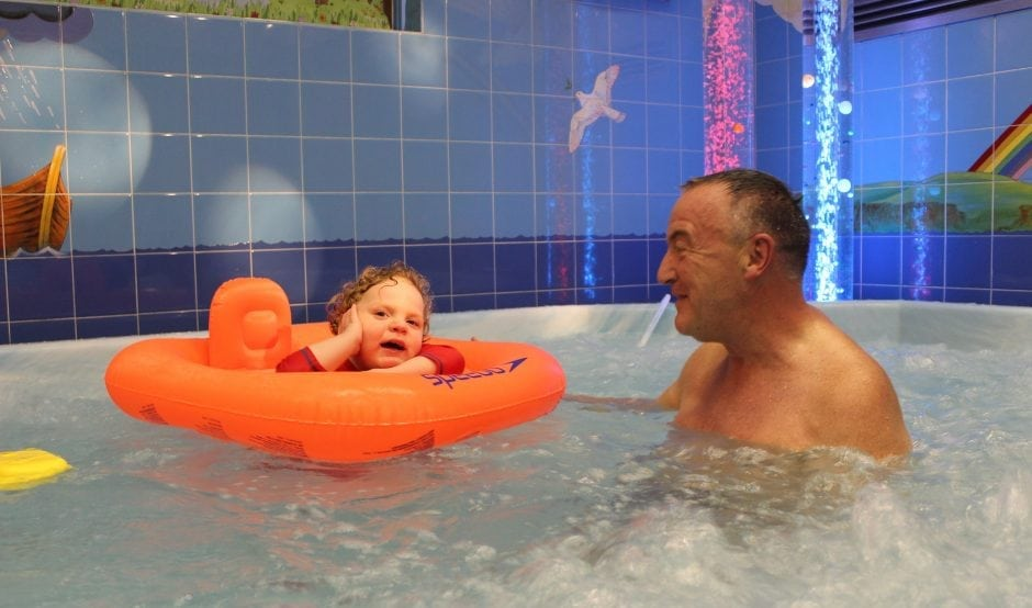 Father and son in jacuzzi at Francis House
