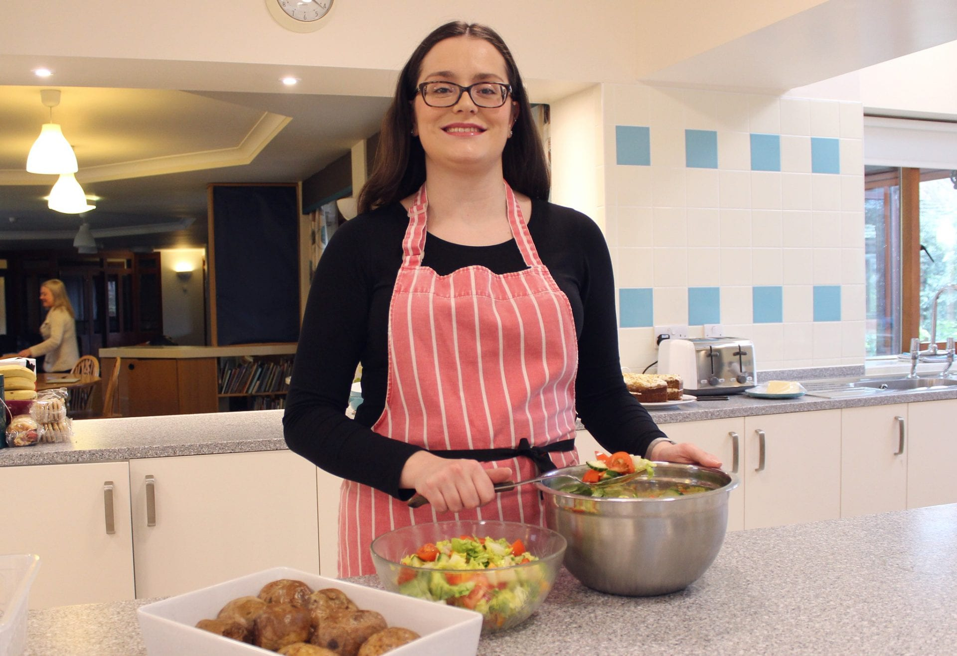 Laura preparing meals in the kitchen