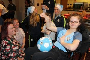 Man City players visit Francis House families