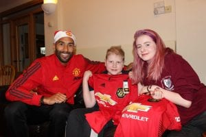 Mancheter United player with Francis House family