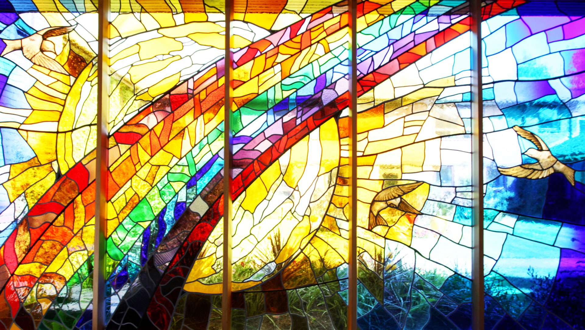 Chapel stained glass window with rainbow