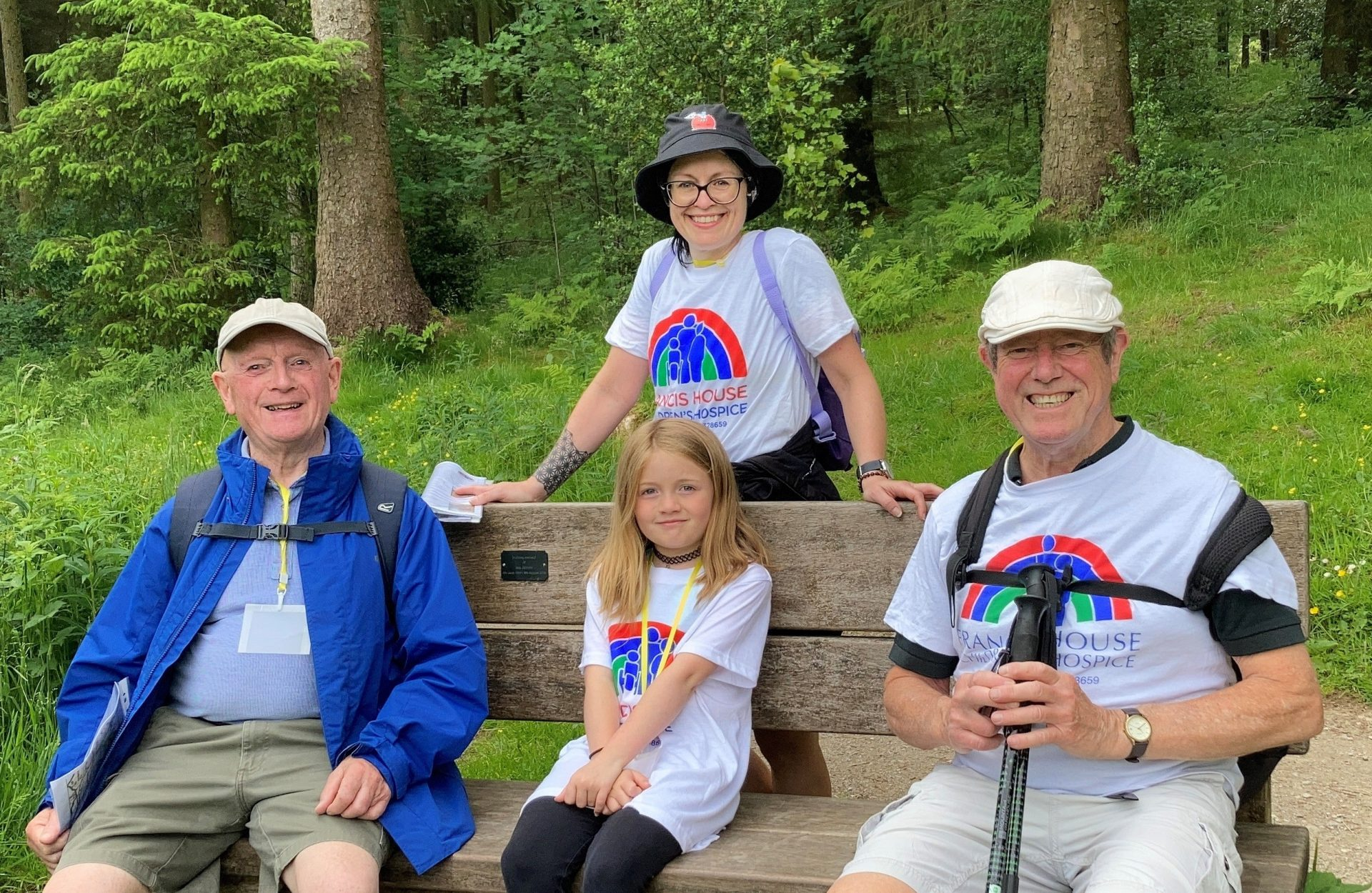 Family sat on bench in forest